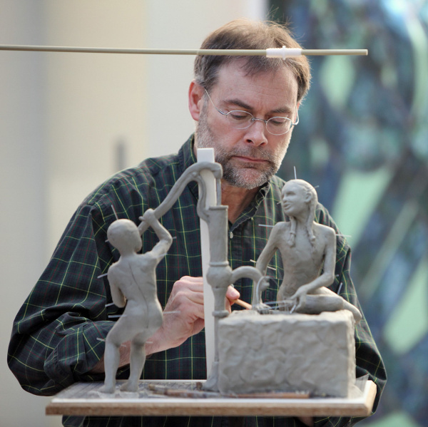 Sculptor Michael Tizzano working on a small-scale model of a work that he has been commissioned to create for the plaza at Bridge and High streets in Dublin